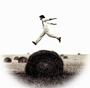 guy-jumping-over-hay